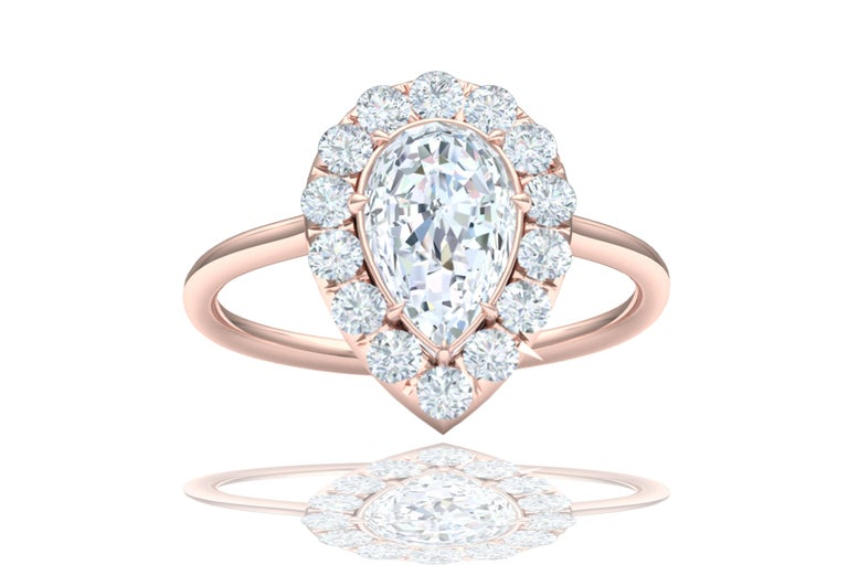 Modern 1 Carat GIA Certified Pear Shape Diamond Halo Rose Gold Engagement Ring For Sale
