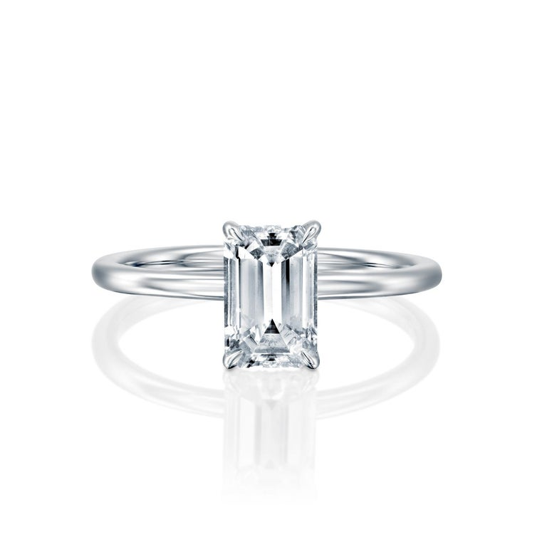 This breathtaking ring features a solitaire GIA certified diamond. Ring features a 1 carat emerald cut 100% eye clean natural diamond of F-G color and VS2-SI1 clarity. Set in a sleek, 18K white gold, solitaire ring with a 4-prong setting, this