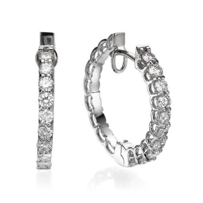A handmade Diamond hoop earrings made of 18K White Gold set with 20 Diamonds . The total carat weight of these beautiful eiamond drop earrings is 1.00 carat.    Item Specs:  Color: F-G   Clarity: VS-SI     Main Stone:   These dangle earrings can be