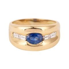 1 Carat Oval Ceylon Sapphire Baguette Diamonds 18 Carats Yellow Gold Band Ring