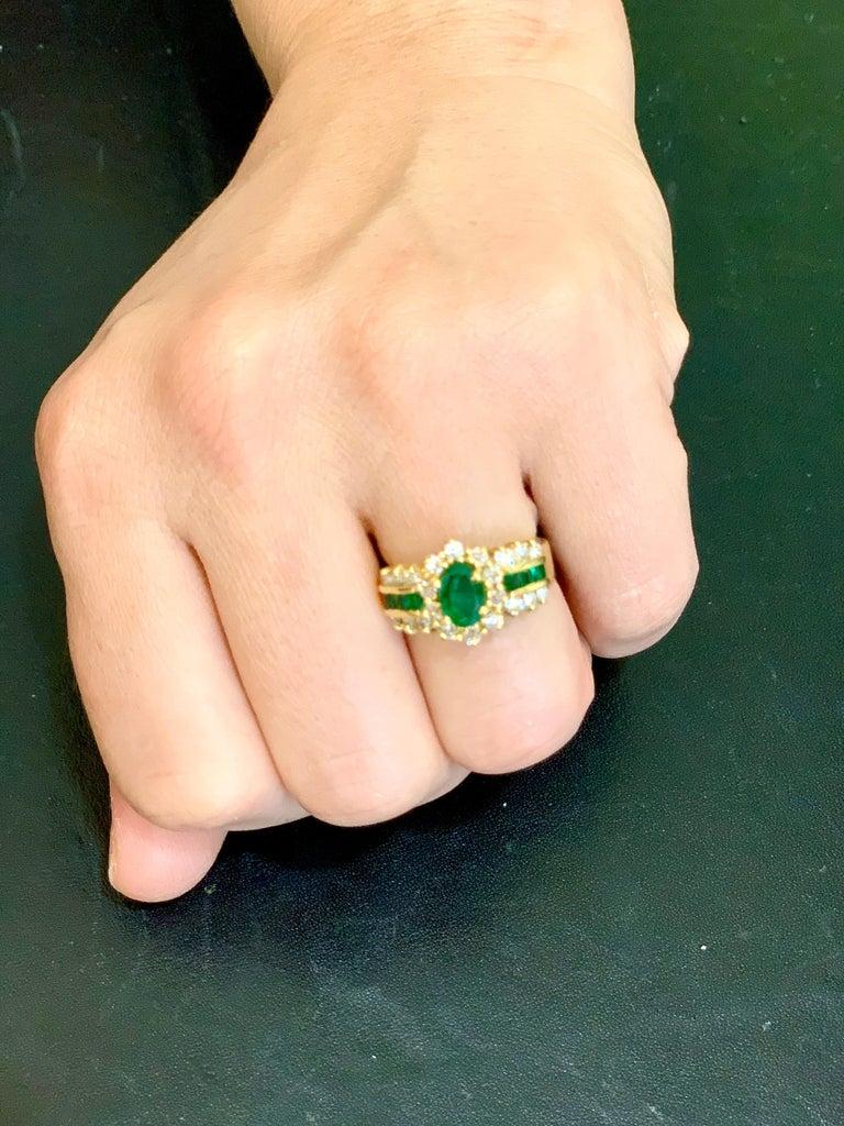 Women's 1 Carat Oval Cut Emerald and 1.0 Carat Diamond Ring 18 Karat Yellow Gold For Sale