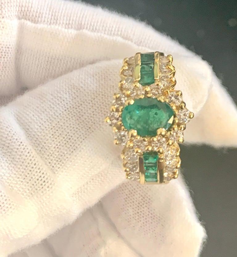 1 Carat Oval Cut Emerald and 1.0 Carat Diamond Ring 18 Karat Yellow Gold For Sale 1