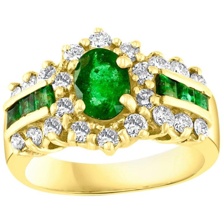 1 Carat Oval Cut Emerald and 1.0 Carat Diamond Ring 18 Karat Yellow Gold For Sale