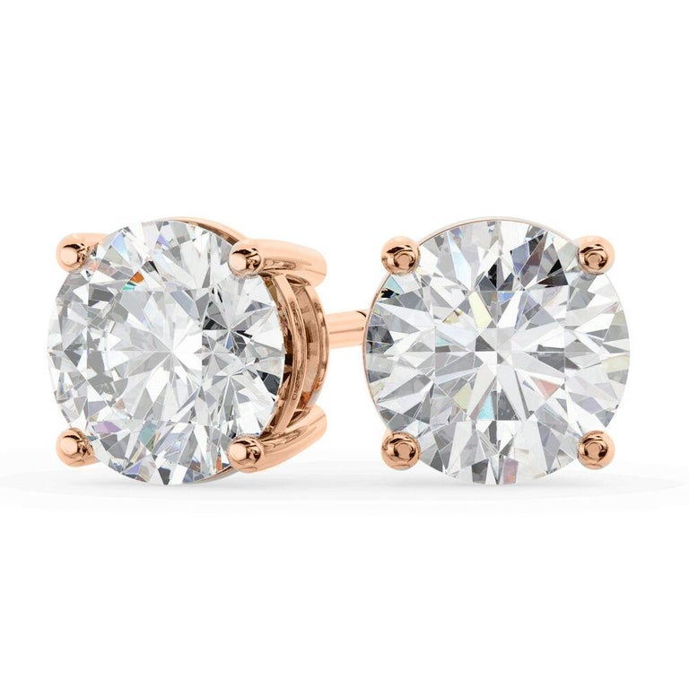 Each Stone is 0.50 carat which makes the total of 1 carat. The quality of the diamonds are F color ( colorless) with VS to SI clarity ( clean ). The classic round cut diamond stud earrings comes in three different settings. The first and second