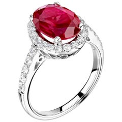 1 Carat Ruby and Diamond Bespoke Halo Ring in Platinum