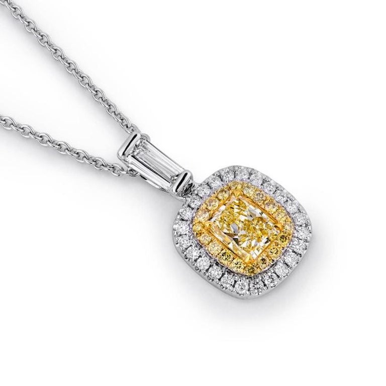 Clarity: VS  Metal: White Gold Main Stone: Yellow Diamond 0.58ctw Side Stone Weight: Diamonds 0.43ctw Total Diamond Carat Weight: 1.1ctw