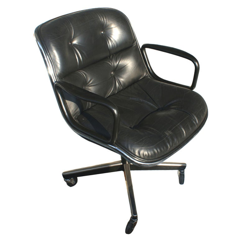 1 Mid-Century Modern armchair on casters designed by Charles Pollock for Knoll in 1965. These chairs could be used in an office, conference room, or dining room. Original tufted, black leather upholstery, chrome trim and swivel base.