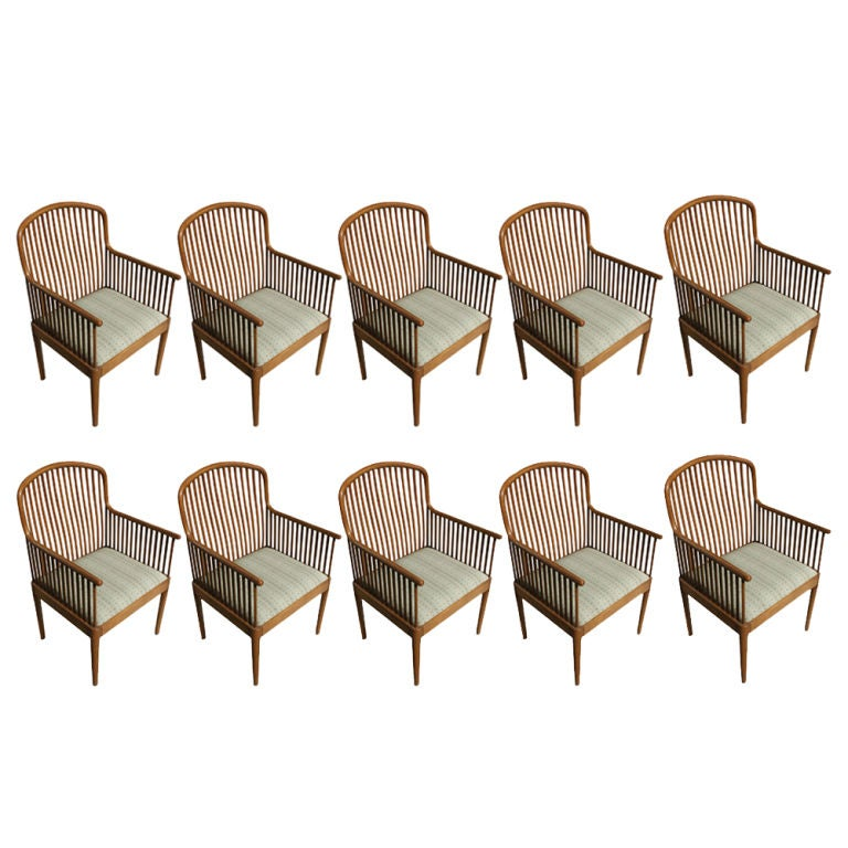 One exeter chair designed by Davis Allen for Knoll in 1983.   Medium brown oak frames with green and beige upholstery. Multiple available.