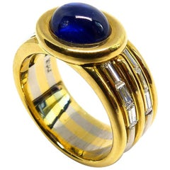 1 Magnificent Sapphire Cabouchon with 12 Diamonds Set in Yellow/White Gold Ring