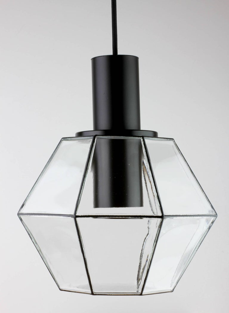 One of a set of ten Minimalist German made pendant light fixtures by Glashütte Limburg, circa 1970s. The simple, yet striking, clean lined modernist design looks effortlessly timeless and would fit equally well into any midcentury home as well as