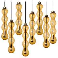 1 of 14 Glass Amber Pedant Lights, Doria, 1960s