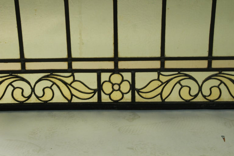 North American 1 of 2 Arched Stained Glass Window For Sale