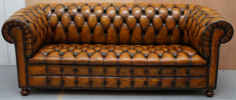We are delighted to offer for sale 1 of 2 stunning rare original vintage Whisky brown leather Chesterfield club sofas in newly restored condition with fully buttoned base   This sofa is one of a pair, I have another which is exactly the same model