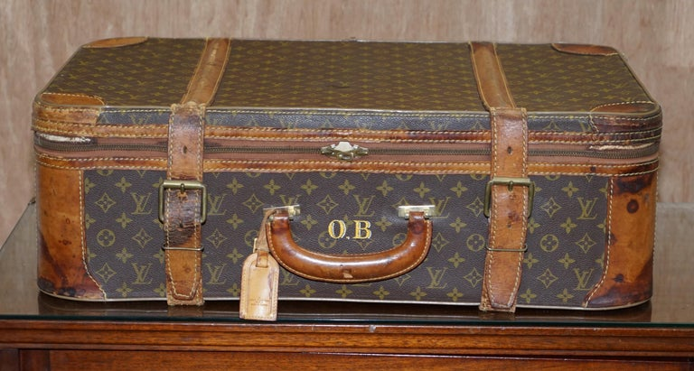We are delighted to offer for sale 1 of 2 original vintage brown leather strapped Louis Vuitton suitcases with original swing tag and bronze buckles  This listing is for one, the other is listed under my other items  A very good looking and well