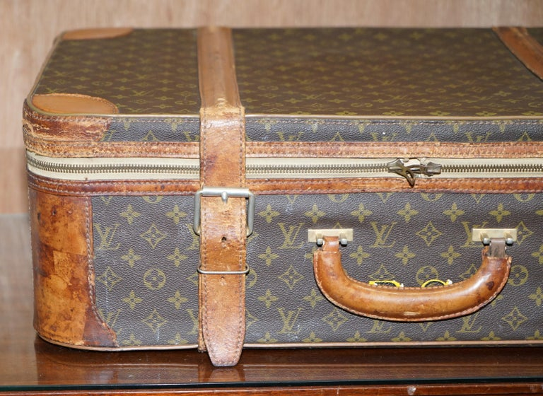 We are delighted to offer for sale 1 of 2 original vintage brown leather strapped Louis Vuitton suitcases with original bronze buckles  This listing is for one, the other is listed under my other items  A very good looking and well made piece,