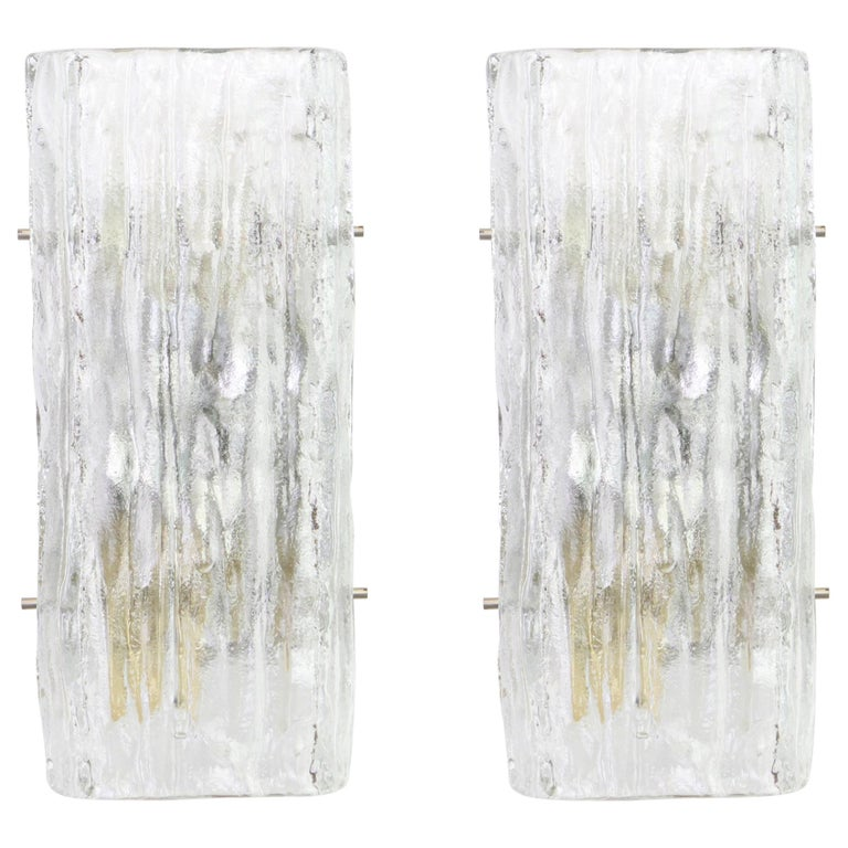 Wonderful pair of midcentury wall sconces with ice glass, made by Kalmar, Austria, manufactured, circa 1960-1969.