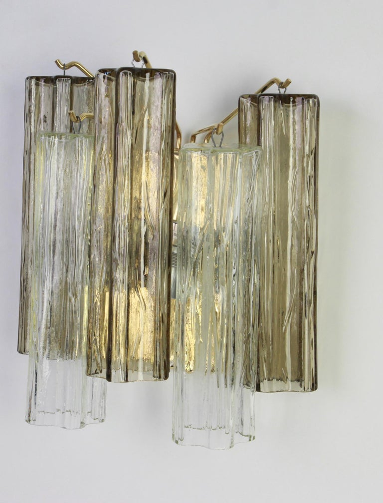 Wonderful pair of midcentury wall sconces with three large Murano glass pieces on a brass frame in each wall lamp, designed by Venini and made by Kalmar, Austria, manufactured, circa 1960-1969. Each sconce needs two x E27 standard bulbs. Light