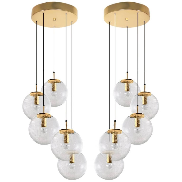 1 of 4 absolutely amazing huge ceiling mount pendant light fixtures with five globes or spheres by Limburg Glashütte. With handblown glass pendants. Complete with a special new custom-made ceiling plate for five globes. Very suitable for building