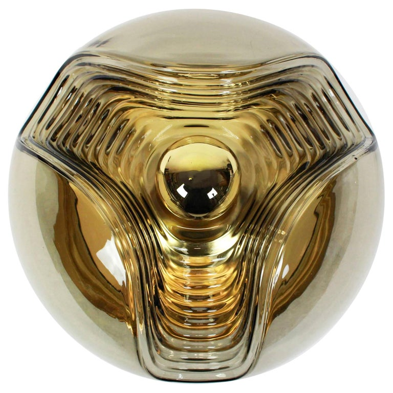 A special round biomorphic smoked glass wall sconce or flush mount designed by Koch & Lowy for Peill & Putzler, manufactured in Germany, circa 1970s.  High quality and in very good condition. Cleaned, well-wired and ready to use.   Each fixture