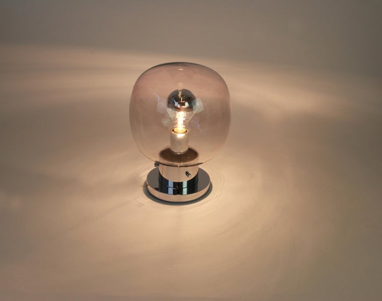 Stunning midcentury ceiling or wall lamp in ball shape, by Glashütte Limburg, Germany, 1970s. Made of smoked glass and chrome. Sockets: It needs 1 x E27 standard bulb and function on voltage from 110 till 240 volts. Light bulbs are not included.
