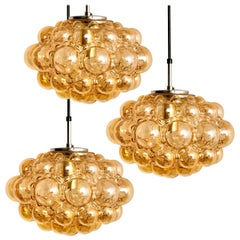 1 of the 3 Amber Bubble Glass Pendant Lamps by Helena Tynell, 1960