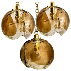 1 of the 3 Kalmar Chandelier Pendant Lights, Smoked Glass and Brass, 1970s