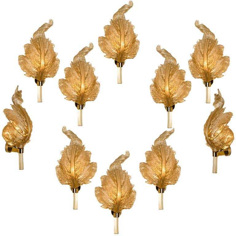 One of the six elegant and exquisite hand blown Murano glass Barovier & Toso wall sconces with special gold inclusions. Each light fixture consists one blown Murano glass leave. Mounted on a brass frame. The leaves refract light beautifully. The