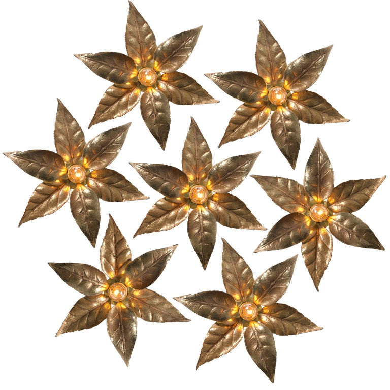1 of 6 very nice massive flower wall lights, made in Belgium in the 1970s. In a style reminiscent of designs by Willy Daro. These lights are made of brass and look like a life-size big flower, very nice sculpted in brass.  The golden brass