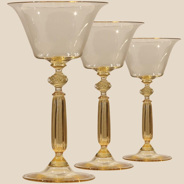 1 of the 6 gorgeous hand-blown Signoretto cocktail glasses with a wonderful clear and gold infused in the glass. Get a feel for how Venetian nobles lived and entertained centuries ago and enjoy Old World European elegance with these fine Venetian