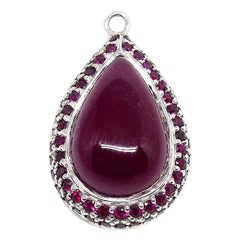 1 Ruby Cabouchon Set in a 18 Karat White Gold Pendant with Ruby Pavé