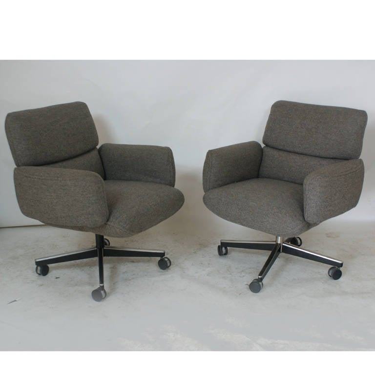 Chair is upholstered in original gray fabric.  Four star swivel and tilt base with casters.