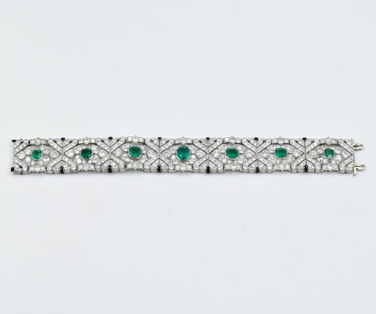 This estate Art Deco 1920's diamond bracelet features a suite of seven fine quality Columbian emeralds which have been certified by AGL.  The emeralds do range in size with a rectangular or square step cut giving it a very unique appeal.  This