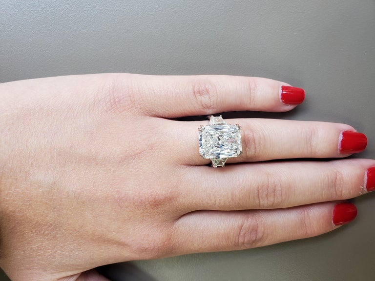 Hello 10 CARAT DIAMOND with 1.13 carat of side diamonds.  This Gorgeous Three Stone Diamond Engagement Ring will make everyone really take notice! What an amazing quality diamond and this size is so rare!  Metal Quality: Platinum Center Diamond: