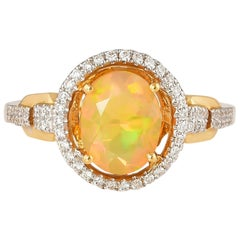 1.0 Carat Ethiopian Opal with Diamond Ring in 18 Karat Yellow Gold