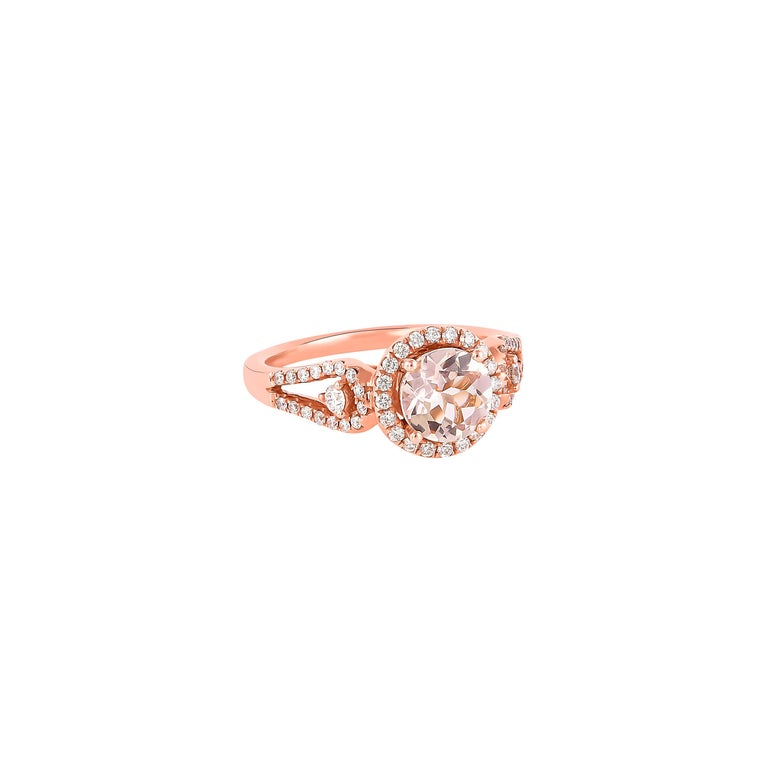 This collection features an array of magnificent morganites! Accented with diamonds these rings are made in rose gold and present a classic yet elegant look.   Classic morganite ring in 18K rose gold with diamonds.   Morganite: 1.03 carat round