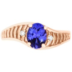 1.0 Carat Oval Shaped Tanzanite and 0.03 Carat White Diamond Ring