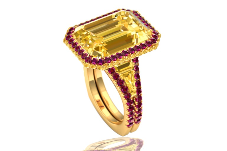 This unique and captivating ring is made up of a rare 7 carat yellow sapphire which has a gorgeous rich golden yellow color and eye clean clarity.  The center stone is complimented by .50 carats of round rich yellow diamonds that have a intense