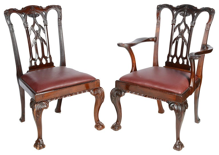 A good quality set of ten (2 arms, 8 single chairs) late 19th century mahogany Chippendale revival dining chairs. Each of the chairs having carved and pierced backrest in a Gothic style, burgundy leather upholstered drop in seats. Raised on carved