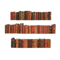 10 Ft. Run of 100 Swedish Antique Leather-Bound Books, in Varying Warm Tones