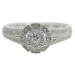 "10 Karat ""Halo"" Diamond Ring"