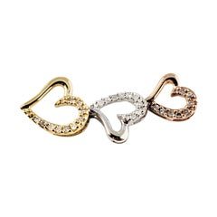 10 Karat Rose and Yellow Gold, Sterling Silver and Diamond Heart Pendant