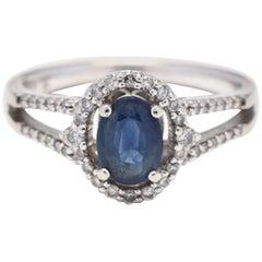 10 Karat White Gold, Blue Stone and Diamond Halo Ring