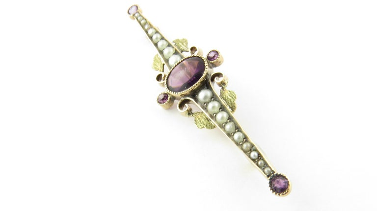 Vintage 10 Karat Yellow Gold Amethyst and Pearl Pin / Brooch  This elegant brooch features four genuine amethyst stones and 18 seed pearls set in beautifully detailed 10K yellow gold.  Size: 14 mm x 51 mm  Weight: 1.8 dwt. / 2.9gr.  Stamped: