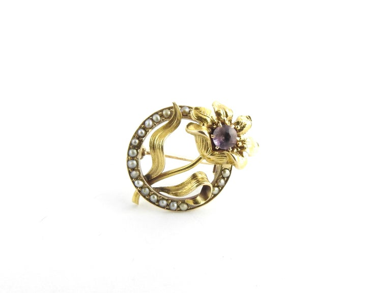 Vintage 10 Karat Yellow Gold Amethyst and Seed Pearl Brooch / Pin  This elegant pin features one round amethyst stone accented with delicate seed pearls set in a lovely 10K yellow gold floral design.  Size: 20 mm x 17 mm  Weight: 1.5 dwt. / 2.4