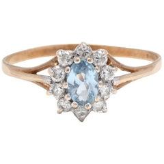 10 Karat Yellow Gold, Blue Stone and Diamond Halo Ring