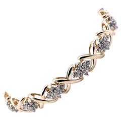 10 Karat Yellow Gold Cluster Diamond X-Tennis Bracelet