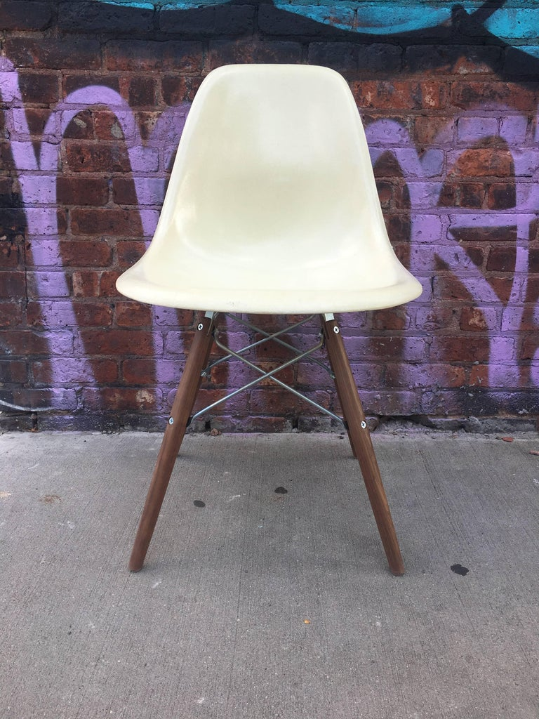 10 Herman Miller Eames multicolored dining chairs. Ships disassembled. Shells in good vintage condition with no holes or cracks. All signed Herman Miller. Shells may vary in color due to the volume. Photo of actual base in last photo. Stained walnut