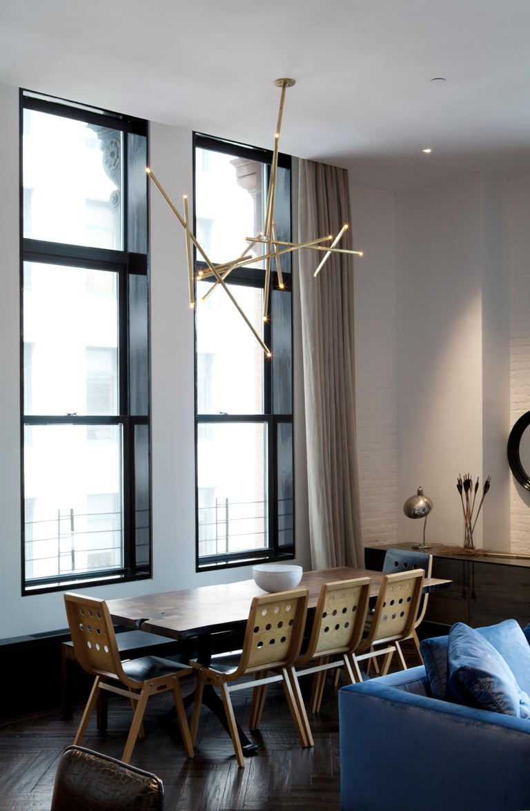 Contemporary 10-Stick Chandelier in Brass by Cam Crockford For Sale