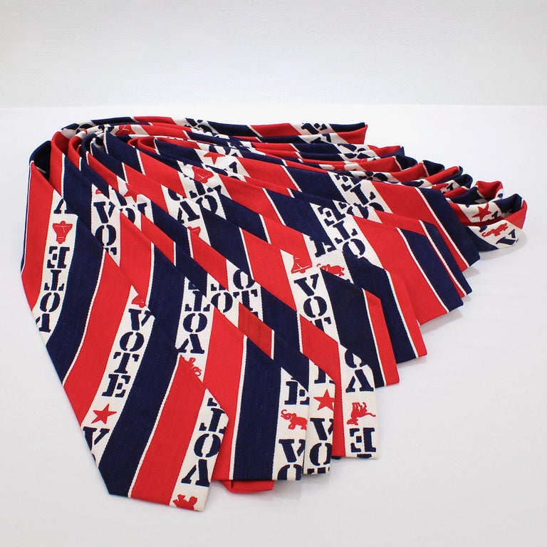 A group of 10 vintage VOTE Neckties.  With a red, white, and blue striped pattern that includes stars, liberty bells, donkeys and elephants.  Likely from the 1970s or early 1980s.  A great time capsule of by-gone elections.  Perfect for the
