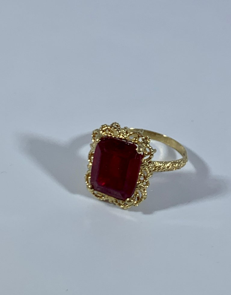 Emerald Cut 7 Carat Treated Ruby 18 Karat Yellow Gold Ring In Excellent Condition For Sale In Scarsdale, NY